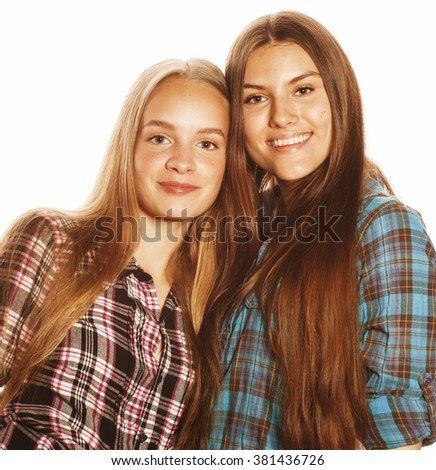 two cute teenagers having fun together isolated on white