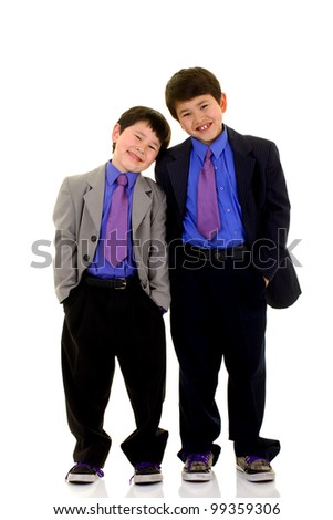 Two cute young boys with great smiles dressed up in suit and ties isolated on white background