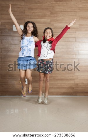 Two cute young girls playing . - stock photo