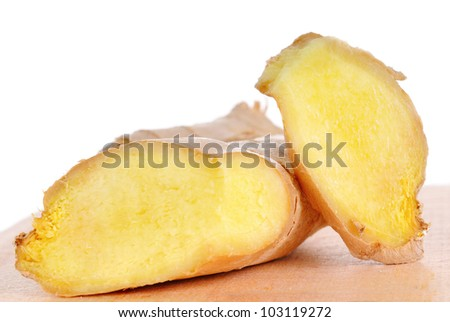 Two cutted ginger roots on wooden board - stock photo