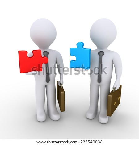 Two 3d businessmen are holding different puzzle pieces - stock photo