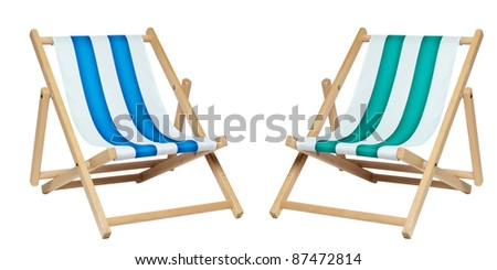 Two deck chair isolated against a white background. Includes clipping path. - stock photo