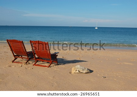 Two deck chairs on a beautiful tropical beach - stock photo