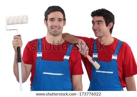 Two decorators dressed exactly the same - stock photo