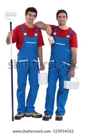 Two decorators dressed in the exact same outfit - stock photo