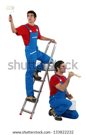 Two decorators wearing matching clothes - stock photo