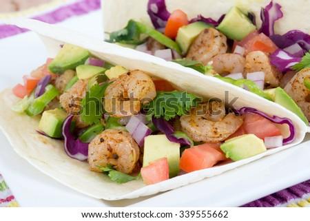 two delicious shrimp tacos closeup - stock photo