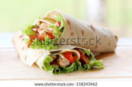 Two delicious tortillas on the table - stock photo