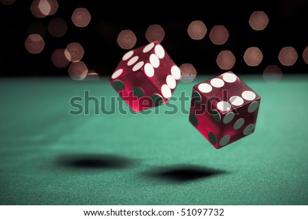 two dice rolling on table - stock photo