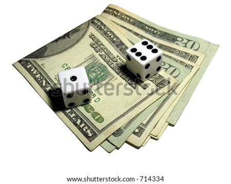 Two dice sitting on top of some money - stock photo