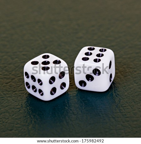 Two dices (five and six) on dark surface - stock photo