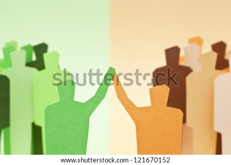 Two different groups reaching a successful agreement - stock photo