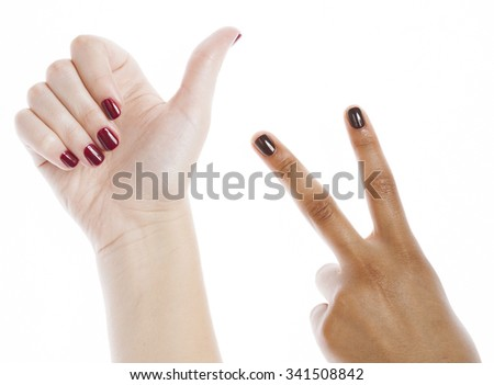 two different nathion manicured hands on white isolated, african with caucasian close up, gesturing ok - stock photo