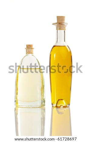Two different oil bottles with two sorts of oil - stock photo