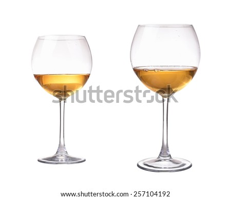 Two different size wineglass with white wine. Concept and idea - stock photo