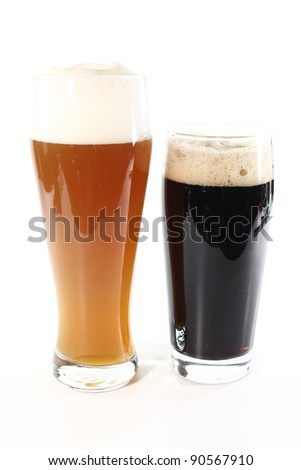 Two different types of beer on a white background