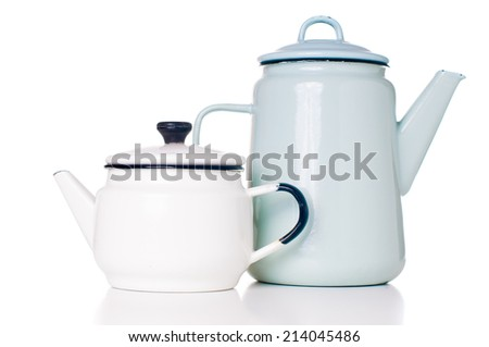 Two different vintage enameled coffee pots, white and blue, isolated on white background