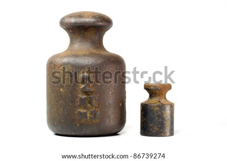 two different vintage weights, on white background