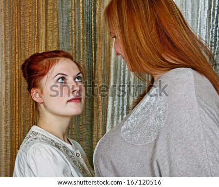 Two different women, small and big. - stock photo