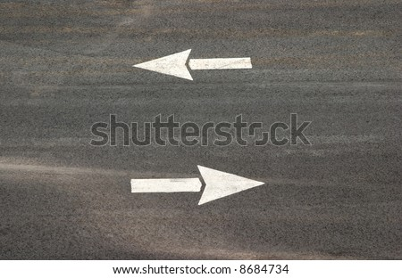 Two directional parking lot arrows. - stock photo