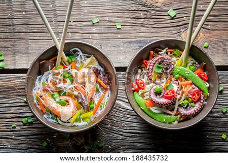 Two dishes with vegetables and seafood - stock photo