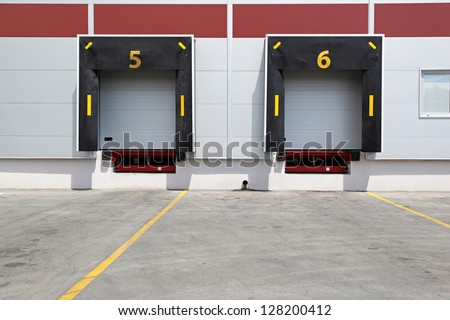 Two dock doors at warehouse for loading lorry - stock photo