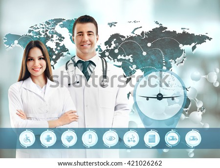 Two doctors and virtual screen. Medical tourism concept