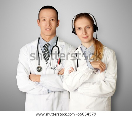 two doctors smiles at camera isolated on different backgrounds - stock photo