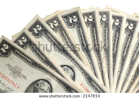 two dollar bills fanned on white background
