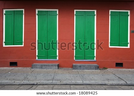 Two doors and two windows of a house in New Orleans, Louisiana, USA
