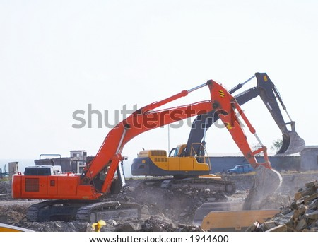 Two dredges dig a foundation pit - stock photo