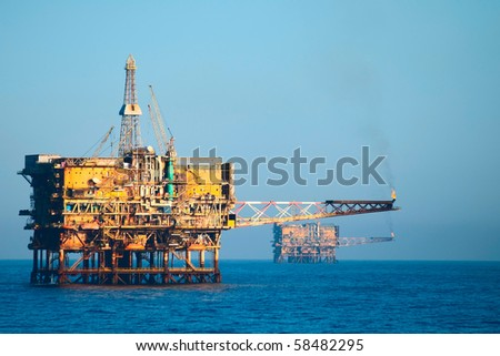 two drilling oil rigs - stock photo