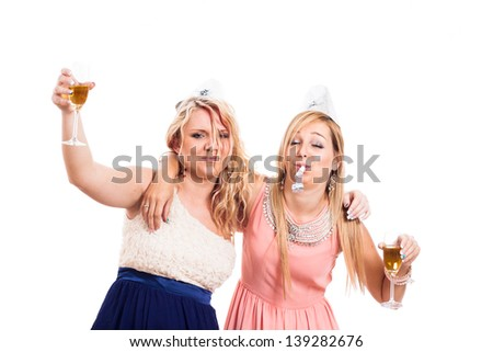 Two drunk girls celebrate with alcohol, isolated on white background - stock photo