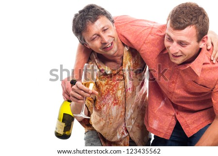 Two drunken men laughing with bottle and glass of alcohol, isolated on white background with copy space. - stock photo