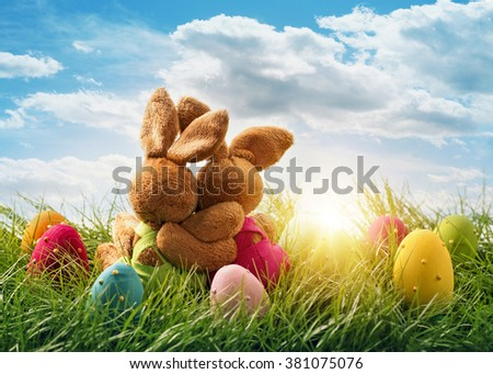 Two easter rabbits sitting on grass - stock photo