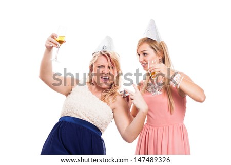 Two ecstatic girls celebrate with alcohol, isolated on white background - stock photo