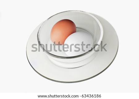 Two eggs in a glass bowl isolated on white