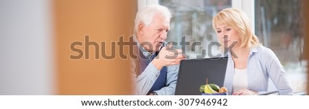 Two elderly business partners talking about company - stock photo