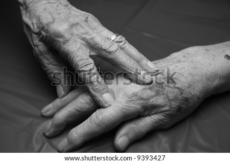 two elderly hands touching - stock photo