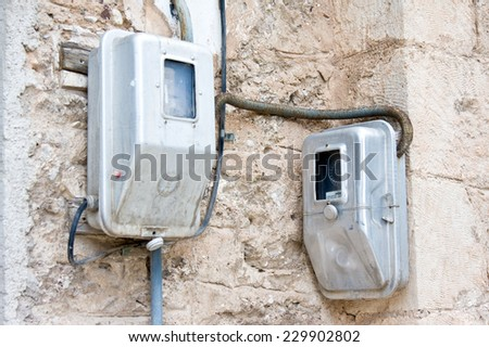 Two electric meters on  wall in smalll traditional Greek village Kalavrita, Peloponnese. Greece - stock photo