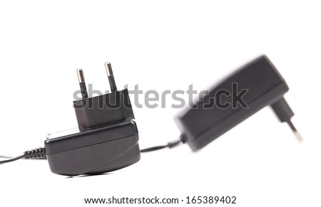 Two electric power adapters. Close up. Isolated on a white background. - stock photo