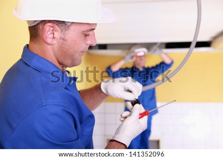 Two electrical engineers working - stock photo