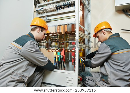 Two Electrician Builder Engineer Works Electric Stock Photo ...
