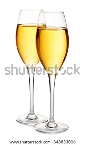 Two elegant champagne glasses close-up isolated on a white background. Festive still life.