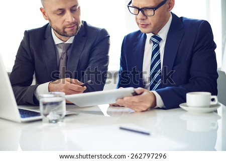 Two elegant men using digital technologies - stock photo