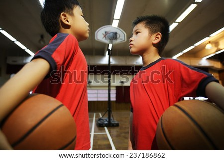 Two Elementary School Students Playing Basketball - stock photo