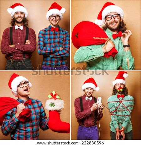 Two emotional Santa Claus dressed in clothes hipster standing near a wall  - stock photo