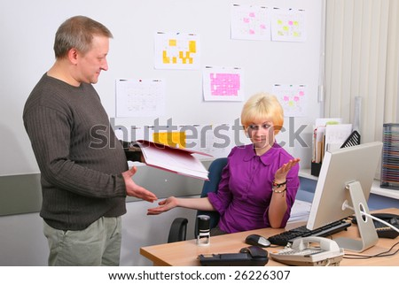 Two employees of office in an operating time