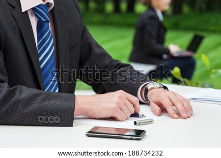 Two employees working at the office outdoors