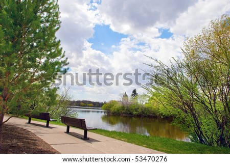 Two empty benches in the city park - stock photo